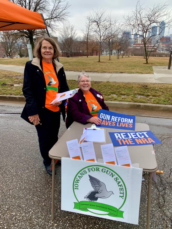 Iowa for Gun Safety volunteers staff an information table
